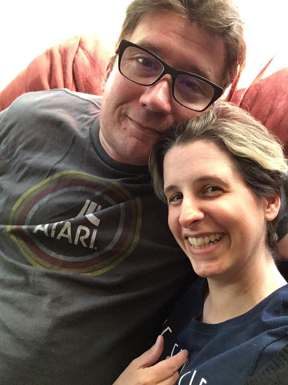 <p>East Lansing couple Erik Grill (left), 43, and Abigail Grill (right), 39, survived COVID-19. Photo courtesy of Abigail Grill.</p>
