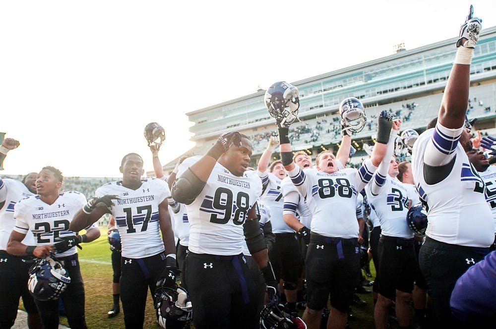 <p>The Northwestern Wildcats celebrate after defeating the Spartans on Saturday, Nov. 17, 2012, at Spartan Stadium. The Spartans&#8217; fell 23-20 to the Wildcats. James Ristau/The State News</p>