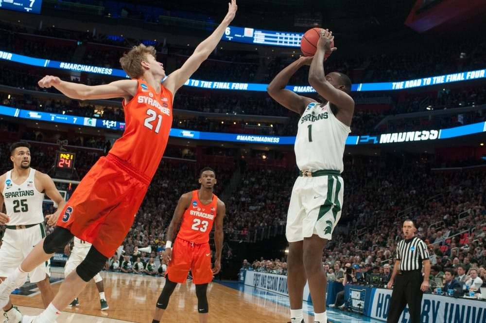 <p>Sophomore guard Joshua Langford (1) shoots the ball during the game against Syracuse on March 18, 2018 at Little Caesars Arena in Detroit. &nbsp;The Spartans fell to the Orange, 55-53 ending their NCAA journey. &nbsp;</p>