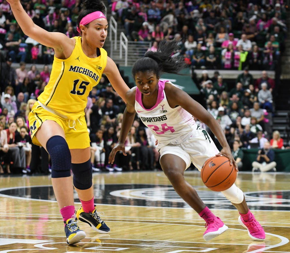 <p>Then-sophomore guard Nia Clouden (24) pushes past a defender during the game against Michigan at the Breslin Center on Feb. 23, 2020. The Spartans fell to the Wolverines, 65-57. </p>