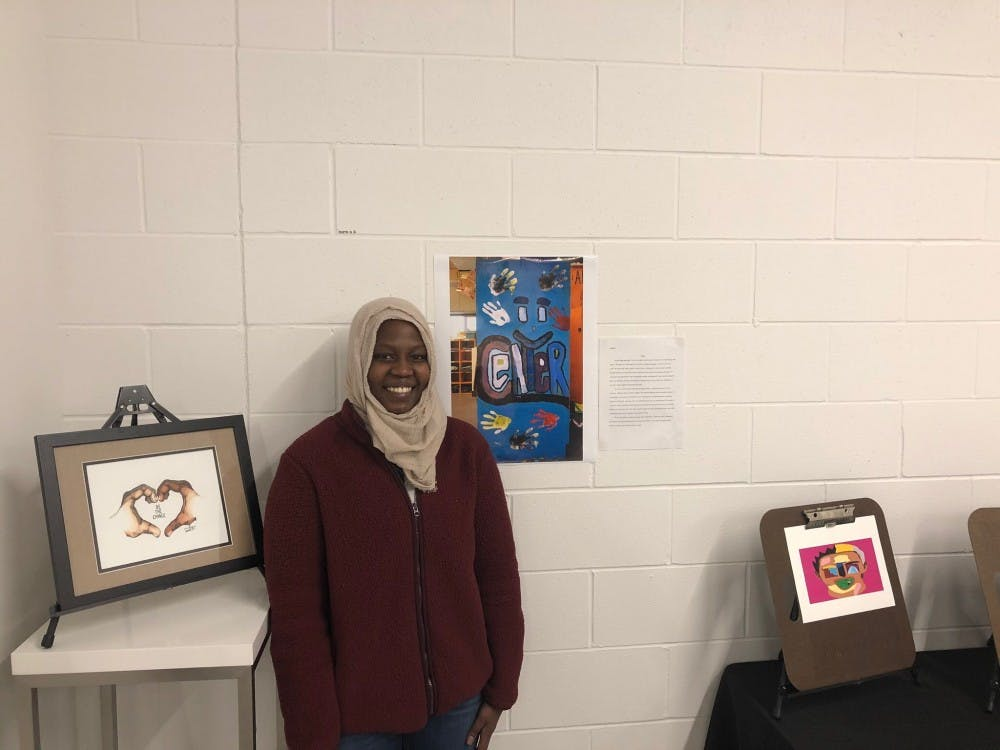 <p>Mark S. McDaniel Legacy Scholarship finalist Siham Hassan presents her painting at the Broad Art Lab.</p>