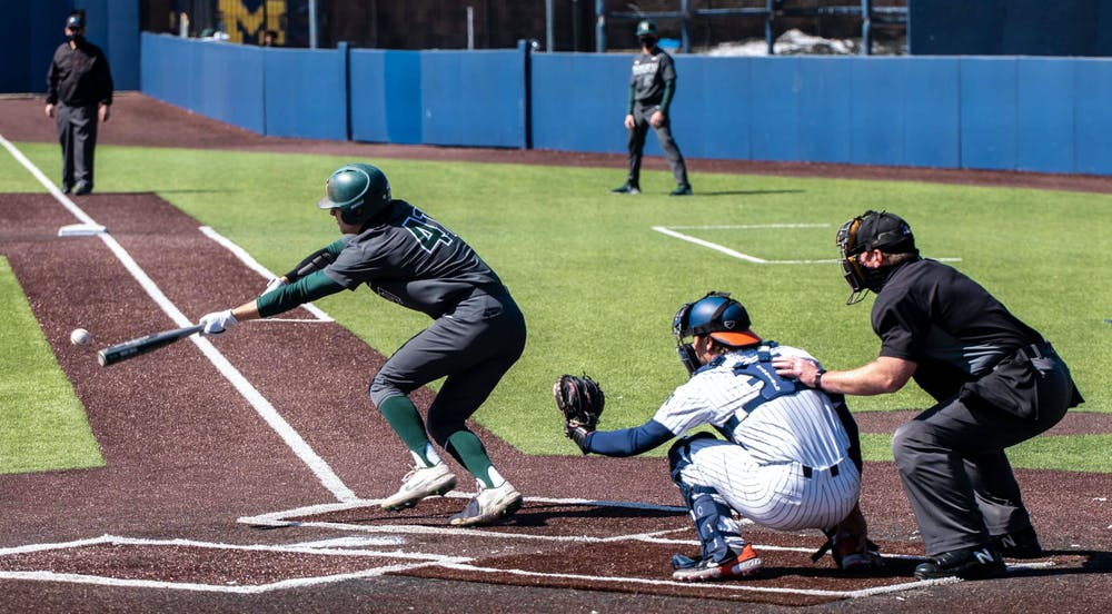 <p>Freshman infielder Mitch Jebb (41) bunts the ball during the fourth inning. The Fighting Illini crushed the Spartans 7-3 at Ray Fisher Stadium on Mar. 21, 2021. </p>