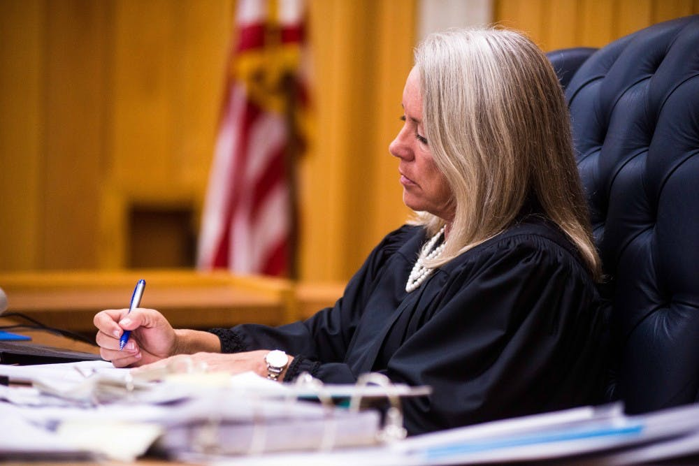 Judge Janice Cunningham takes notes on the second day of sentencing for Larry Nassar on Feb. 2, 2018, in the Eaton County courtroom. Nassar faces three counts of criminal sexual conduct in Eaton County. (Annie Barker | State News)