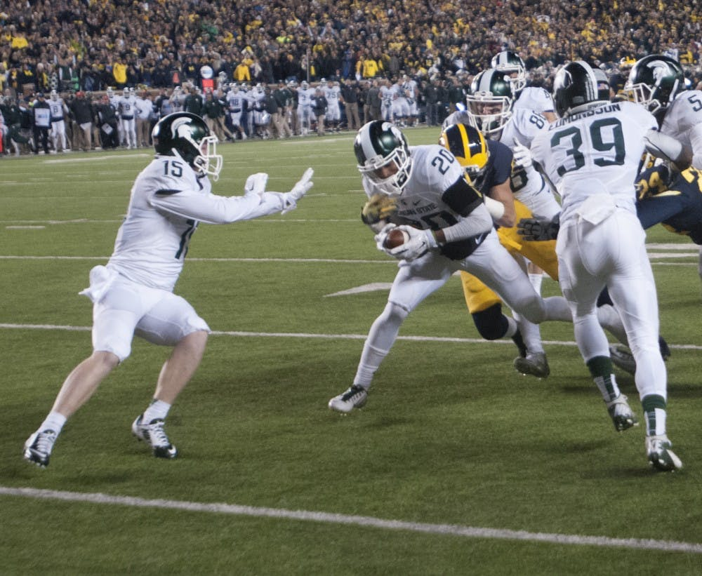 Sophomore defensive back Jalen Watts-Jackson runs the ball for the game winning touchdown during the game against Michigan, on Oct. 17, 2015 at Michigan Stadium. The Spartans defeated the Wolverines 27-23.