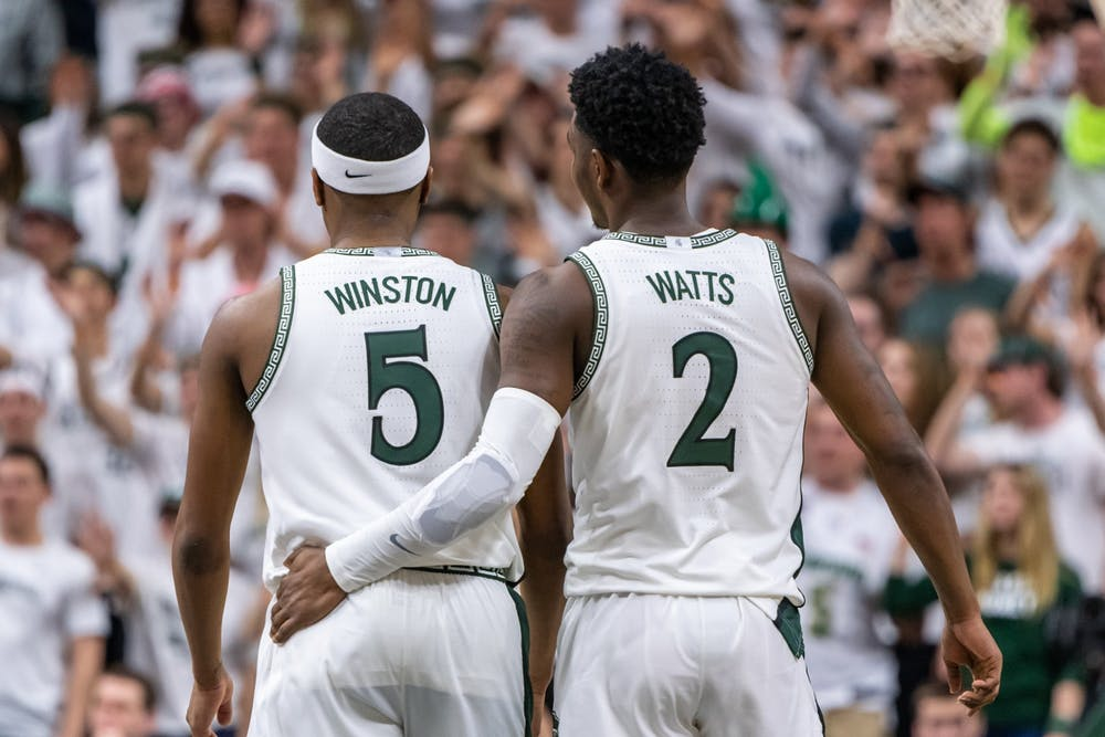 <p>Senior guard Cassius Winston (5) is embraced by freshman guard Rocket Watts (2) during a game against Ohio State. The Spartans defeated the Buckeyes, 80-69, at the Breslin Student Events Center on March 8, 2020. </p>