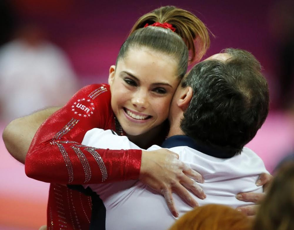 McKayla Maroney of the United States gets a hug from her coach after her performance on the vault as the U.S. women's gymnastics team goes on its way to winning gold in the team competition during the 2012 Summer Olympic Games in London, England, Tuesday, July 31, 2012. Photo: Brian Peterson/Minneapolis Star Tribune/MCT