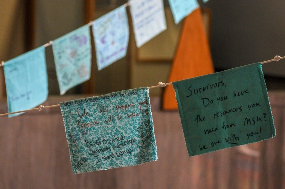 <p>Prayer flags hang during the Finding Our Voice: Sister Survivors Speak Exhibition Opening Ceremony at the MSU Museum on April 16, 2019.</p>