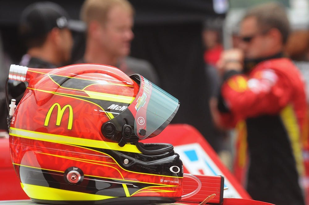<p>NASCAR driver Jamie McMurray&#x27;s helmet rests on his car minutes before the NASCAR Sprint Cup Series Quicken Loans 400 on June 14, 2015 at Michigan International Speedway. Joshua Abraham/The State News</p>