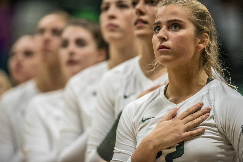 Sophomore defensive specialist Samantha McLean (22) looks at the flag during the National Anthem during the game against Ohio State on Sept. 30, 2017 at Jenison Fieldhouse. The Spartans defeated the Buckeyes, 2-0.