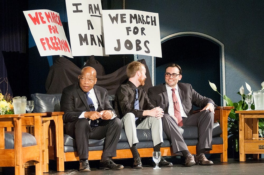 """<p>From left, congressman John Lewis, D-Ga., illustrator Nate Powell, and author Andrew Aydin discuss the book, """"March: Book One"""" during the One Book One Community event Aug. 25, 2014, at Hannah Community Center. """"March: Book One"""" is the first in a series of graphic novels telling Lewis' personal story and journey through the civil rights movement. Raymond Williams/The State News</p>"""