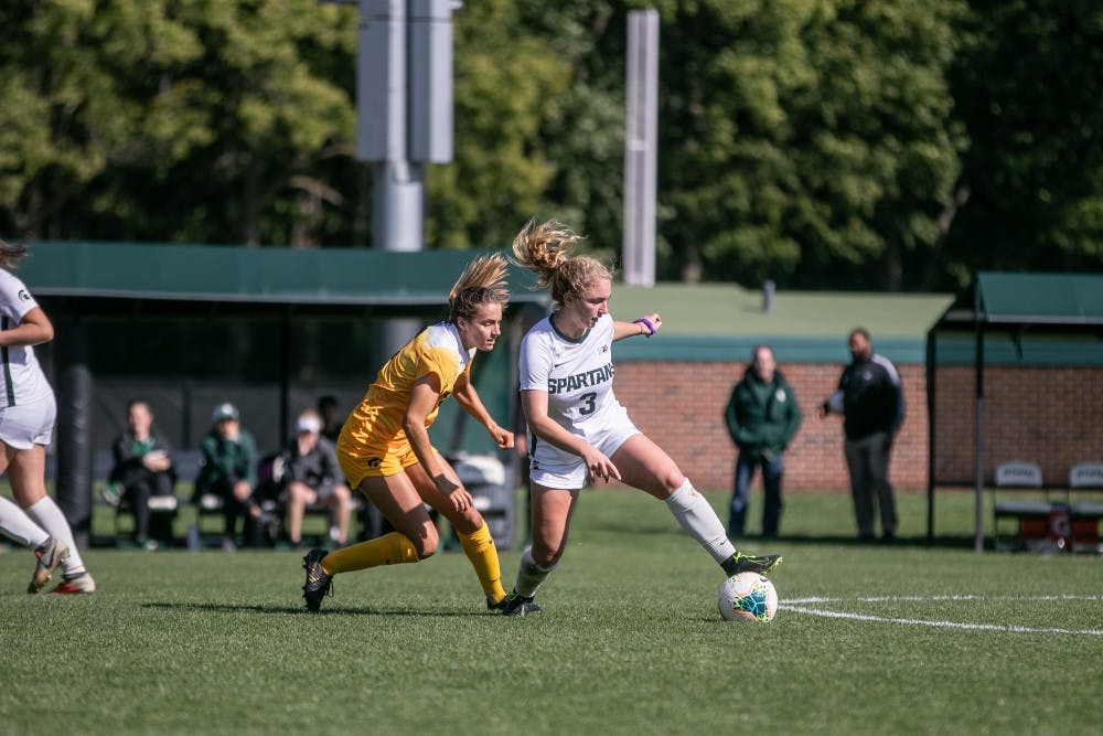 <p>Junior midfielder Danielle Stephan (3) dribbles around a defender during the game against Iowa Oct. 6, 2019. The Spartans fell to the Hawkeyes, 3-0.</p>