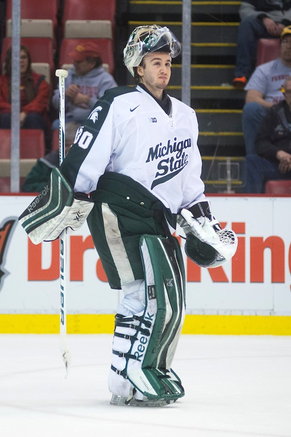 <p>Junior goaltender Jake Hildebrand reacts to a Spartan goal on an empty Ferris State net Dec. 28, 2014, during the 50th Great Lakes Invitational at Joe Louis Arena in Detroit. The Spartans defeated the Bulldogs, 2-0. Danyelle Morrow/The State News</p>