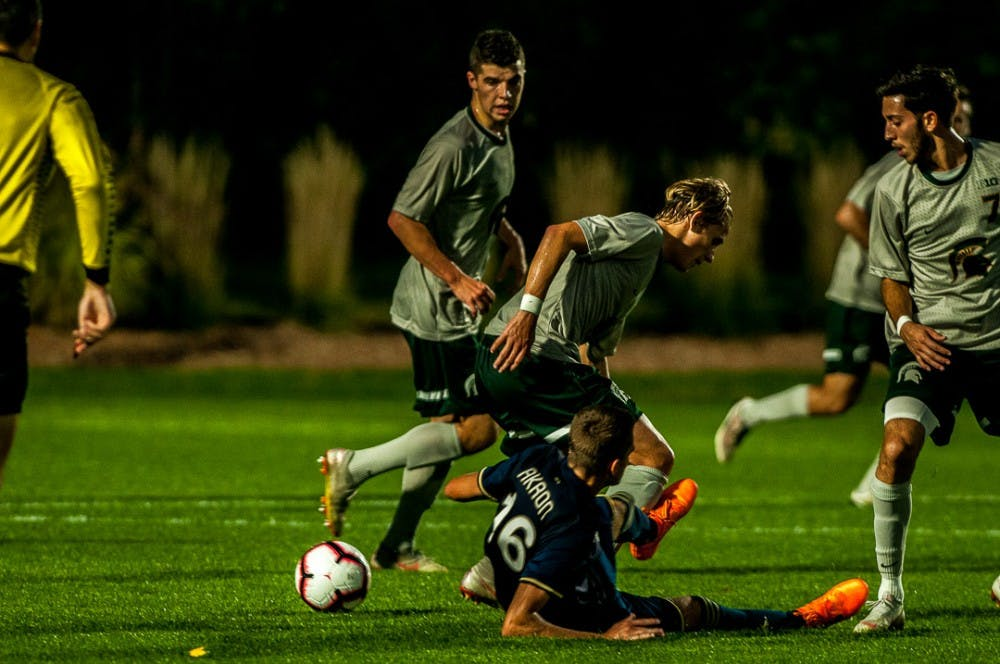 Spartans and Zips fight for the ball during the game against Akron on Oct. 9, 2018 at DeMartin Stadium. The Spartans fell to the Zips, 2-1.