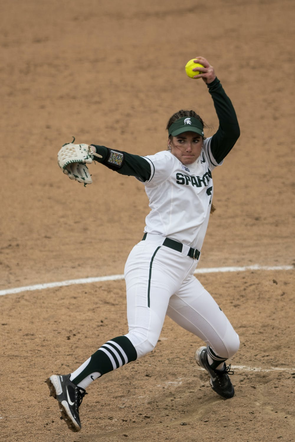 Sophomore pitcher Sarah Ladd (20) throws a pitch during the game against Rutgers on March 28, 2021, at Secchia Stadium. The Spartans defeated the Scarlet Knights 4-1.