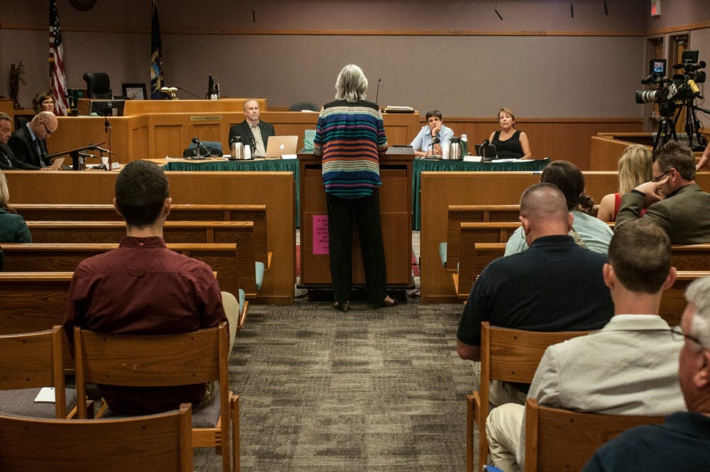An East Lansing resident addresses the council during a city council meeting on Sept. 13, 2016 at East Lansing City Hall. The city council meets to take action on legislative matters on several Tuesdays of each month.