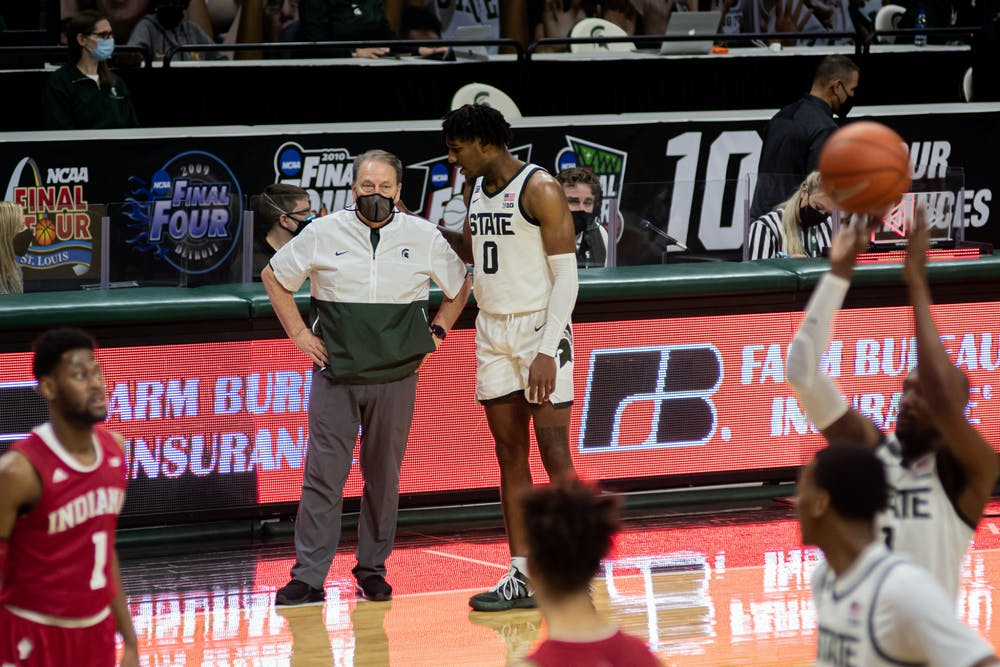 Junior forward Aaron Henry talks to Michigan State head coach Tom Izzo as redshirt senior guard Joshua Langford shoots a free throw. The Spartans defeated the Hoosiers 64-58 on Mar. 2, 2021.