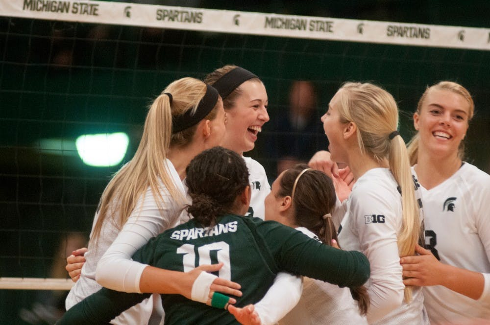 <p>Sophomore middle blocker Alyssa Garvelink celebrates getting a point with her team at the volleyball game against Michigan on Sept. 30, 2015 at Jenison Field House. The Spartans defeated the Wolverines, 3-0. </p>