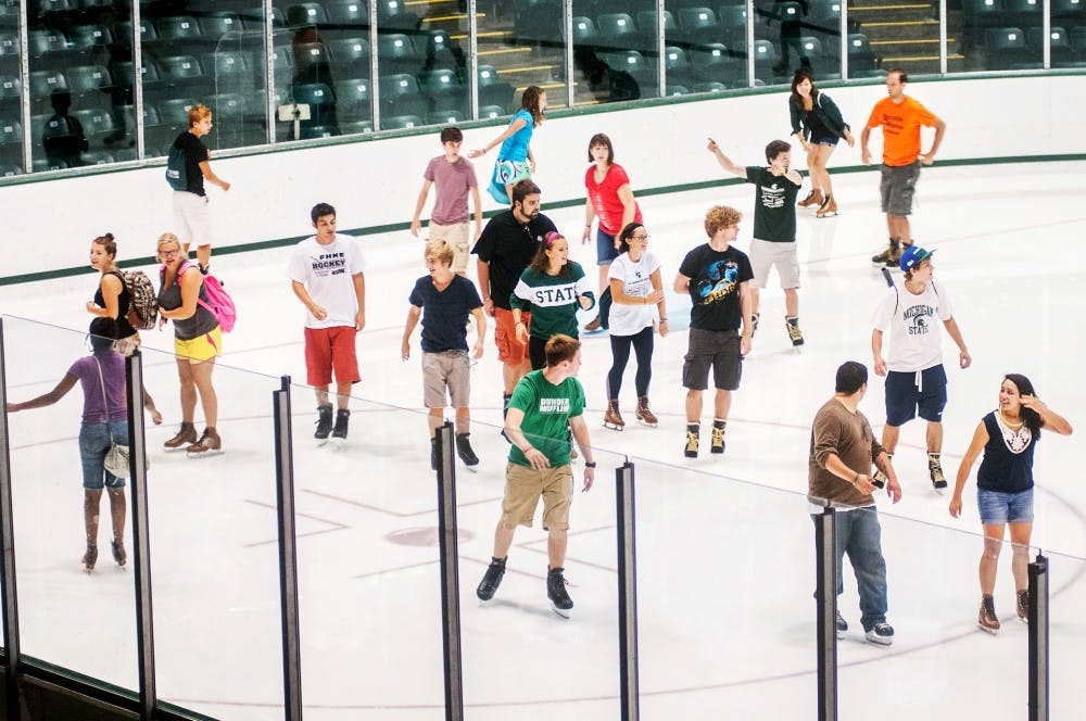 MSU students circle the ice rink during U-Fest Monday, Aug. 27, 2012 at Munn Arena. MSU students were given the opportunity to participate in a variety of activities during the event. Adam Toolin/The State News