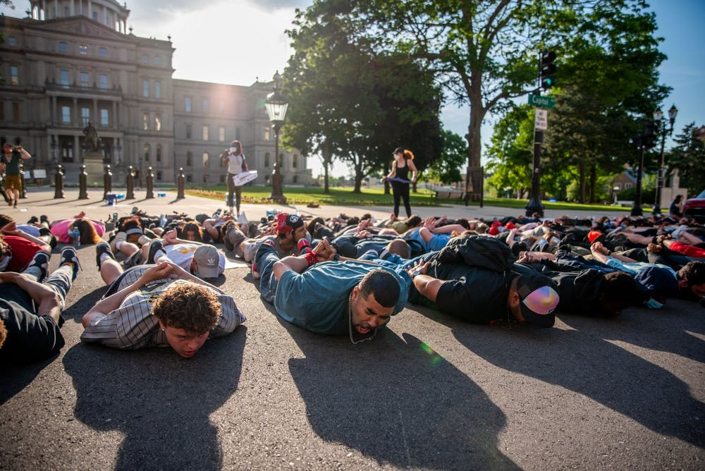 <p>Protesters lie in the street in front of the Capitol as they chant &quot;I can&#x27;t breathe&quot; on June 3, 2020.</p>