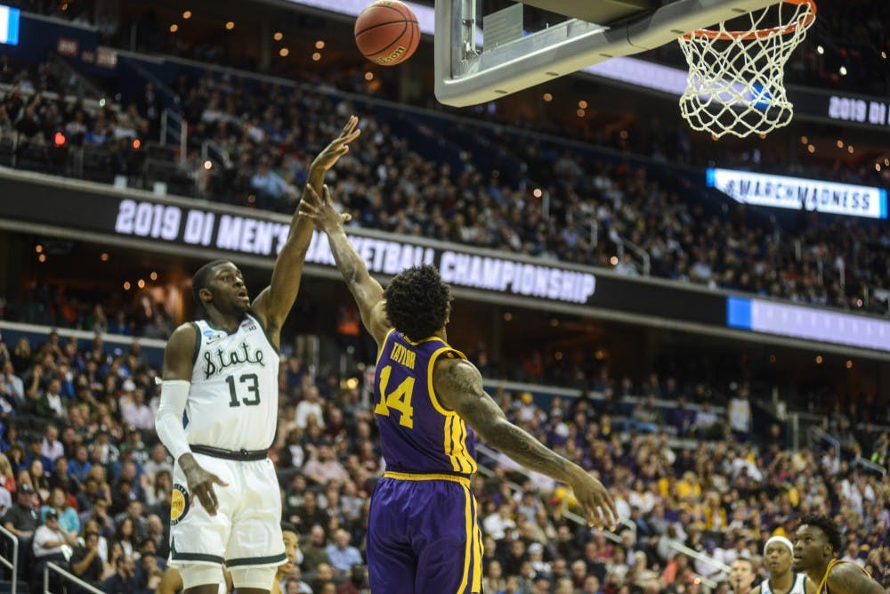 Freshman forward Gabe Brown (13) shoots the ball during the game against LSU at Capital One Arena on March 29, 2019. The Spartans defeated the Tigers, 80-63.