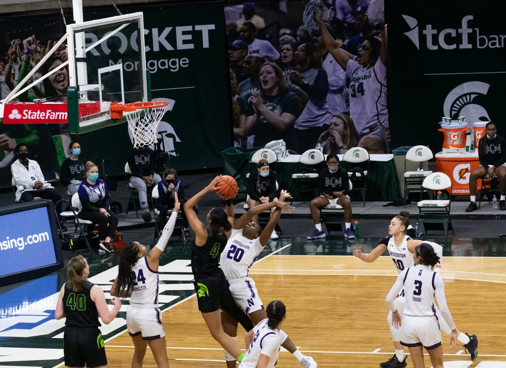 Junior Alisia Smith (4) attempts to score in the Spartans' loss against Northwestern University on Feb. 7, 2021.