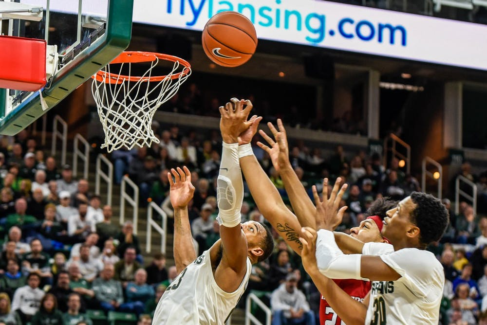 Sophomore forward Marcus Bingham Jr. (30) tries to shoot during the game against Rutgers at Breslin Center on Dec. 8, 2019. The Spartans defeated the Scarlett Knights, 77-65.