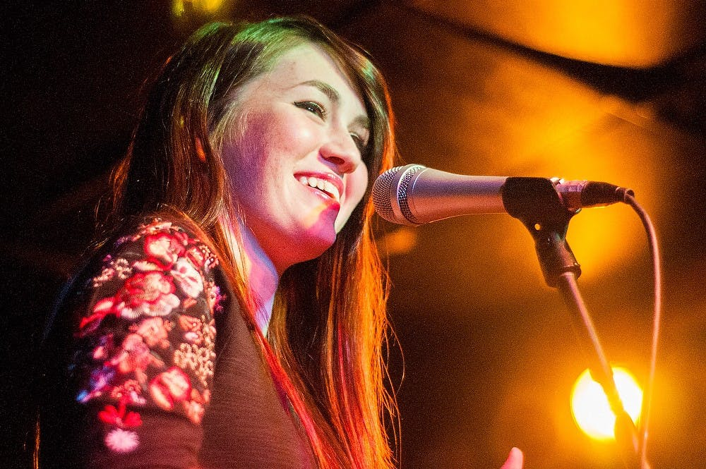 Singer Olivia Millerschin, 17, performs at Mac's Bar, 2700 East Michigan Avenue, during the second annual Mac's Mitten Jam on Saturday, Oct. 6, 2012. State News File Photo