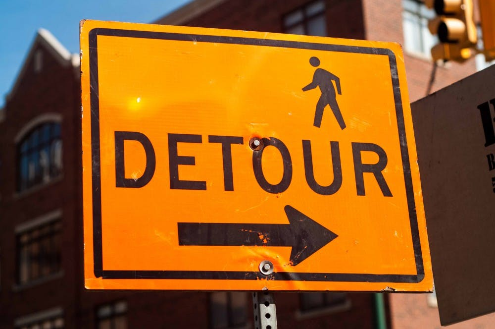 <p>Construction and detours continue on Albert Avenue and on the corner of Abbot Road May 23, 2018. (Annie Barker | State News)</p>