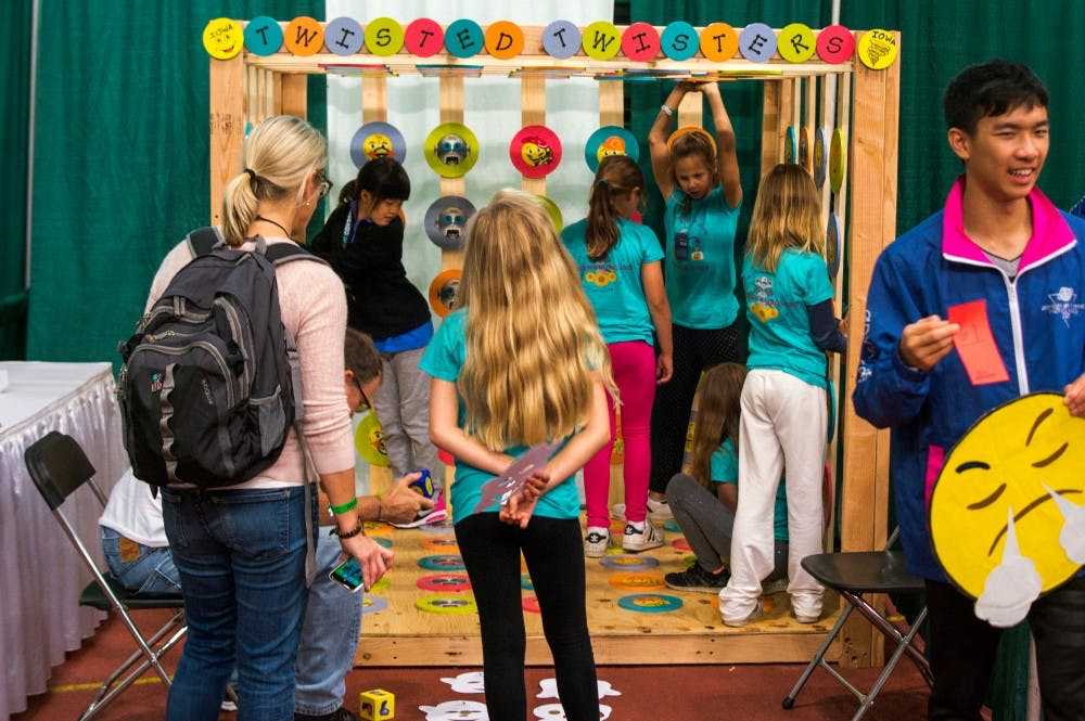 <p>Members of #Odysseysquad, a team from Danville, California work together to solve a puzzle during Odyssey of the Mind on May 25, 2017 at Jenison Field House. This is the 38th World Finals of Odyssey of the Mind, which is a competition that emphasizes creativity and teamwork through problem solving.</p>