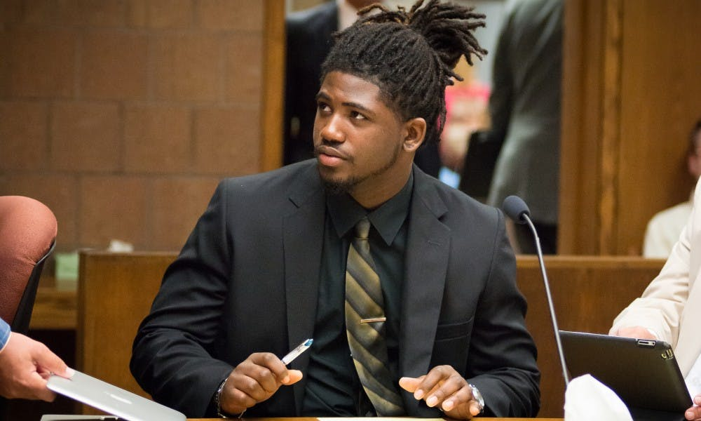 <p>Former MSU football player Auston Roberston looks to his attorney on June 22, 2017, at the 55th District Court in Mason, Michigan. At the hearing Judge Thomas P. Boyd ordered an additional count of third-degree criminal sexual conduct be charged against Robertson for his alleged role in a sexual assault in April.</p>