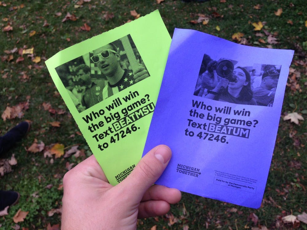<p>Flyers handed out by Hillary Clinton 2016 volunteers before the MSU-Michigan football game on Oct. 29, 2016.</p>