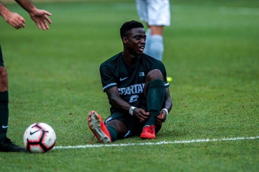 Freshman forward Farai Mutatu (9) ties his shoe during the game against Tulsa on August 26, 2018 at DeMartin Stadium. The game ended in a draw between the Spartans and the Golden Hurricanes.