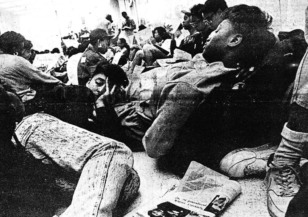 Tired protestors at the 2-day-old-sit-in try to rest their eyes after a long night at the Administration Building.