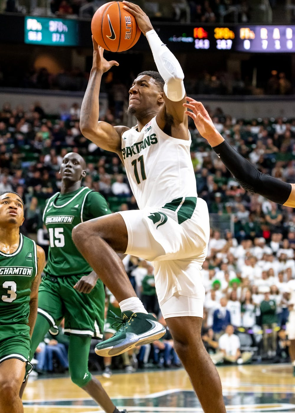 <p>Sophomore forward Aaron Henry goes up for a shot against Binghamton. The Spartans defeated the Bearcats 100-47 at the Breslin Student Events Center on Nov. 10, 2019. </p>