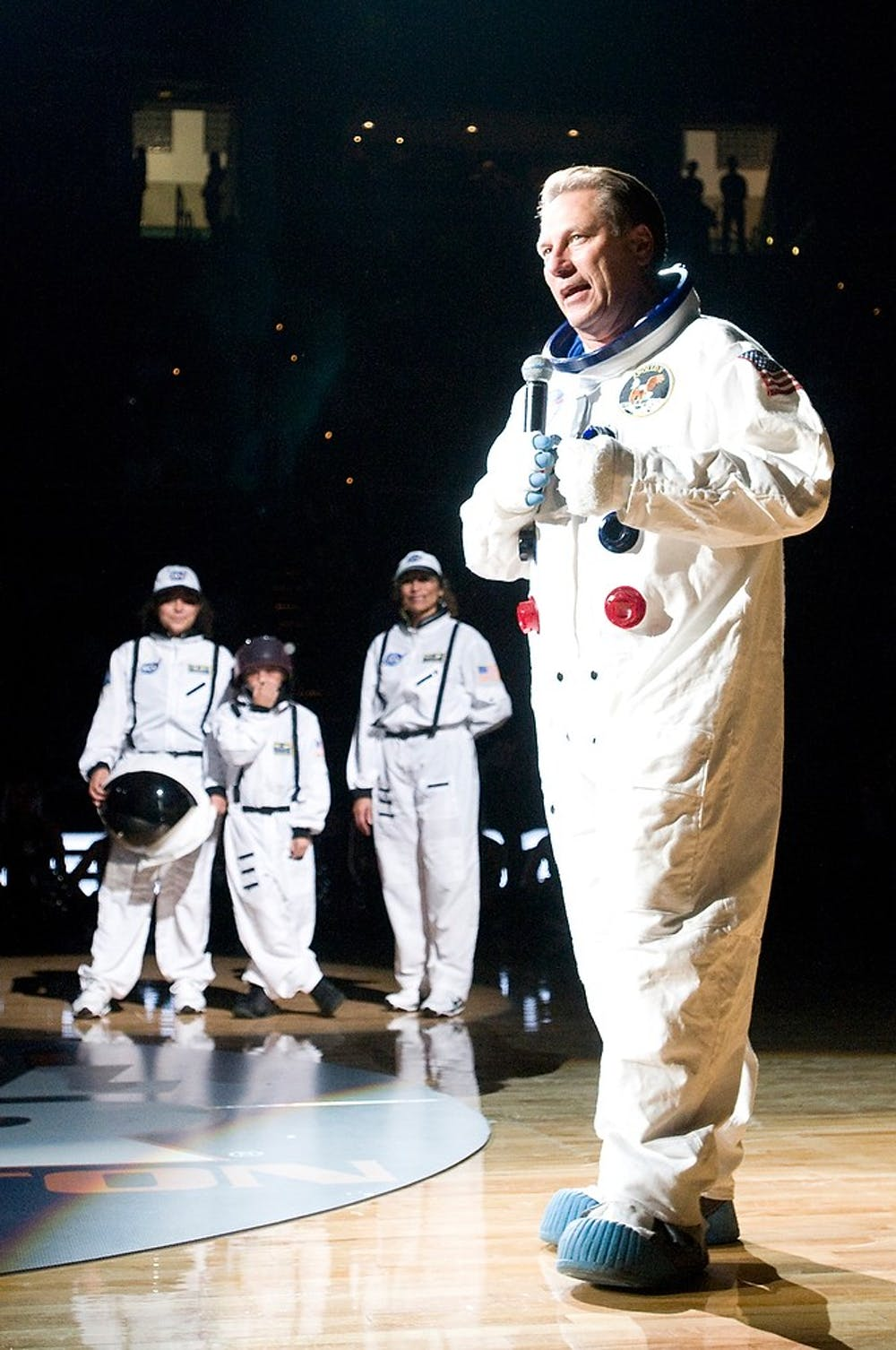 <p>Head coach Tom Izzo talks with students and spectators in an astronaut outfit as his family stands behind him during Midnight Madness Friday, Oct. 15, 2010, evening at Breslin Center. Sam Mikalonis/The State News</p>