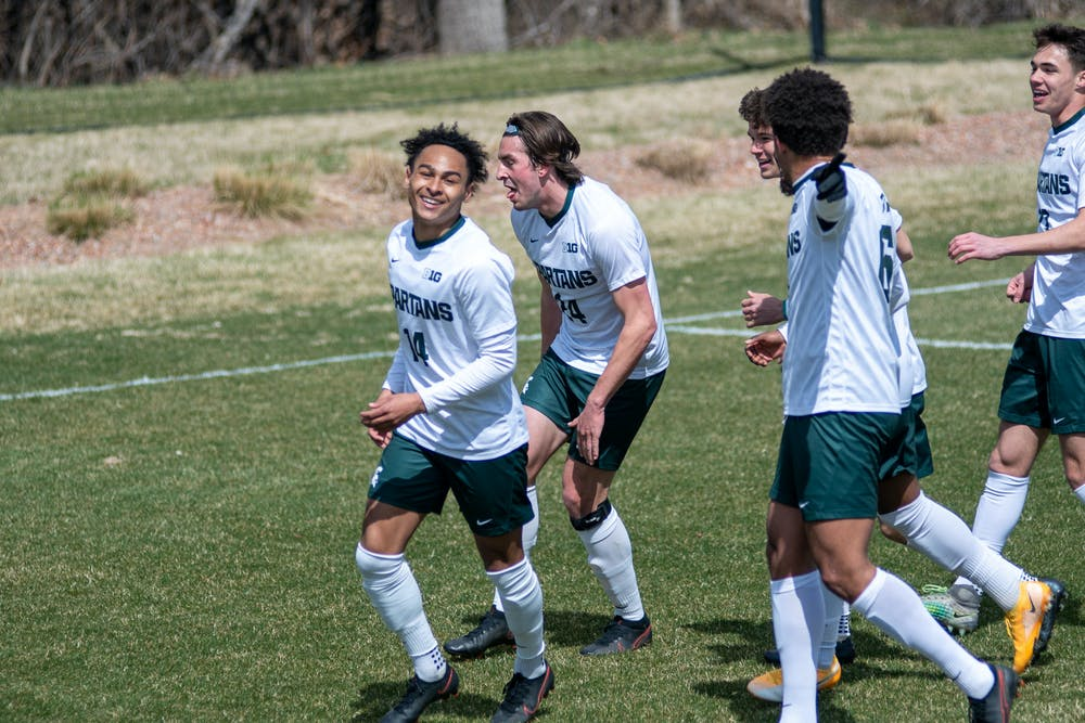 Members of Michigan State men's soccer team celebrating after the first goal in the game against Wisconsin on March 31st, 2021 at DeMartin Stadium in East Lansing.