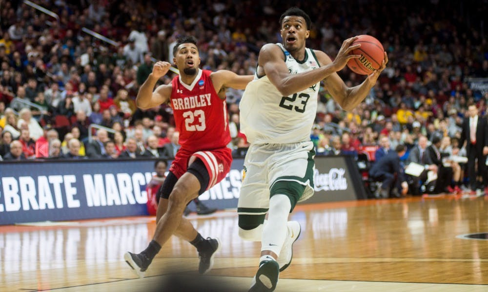 Sophomore forward Xavier Tillman (23) goes to shoot the ball after a Bradley turnover during the NCAA tournament game against Bradley at Wells Fargo Arena March 21, 2019. The Spartans defeated the Braves, 76-65.