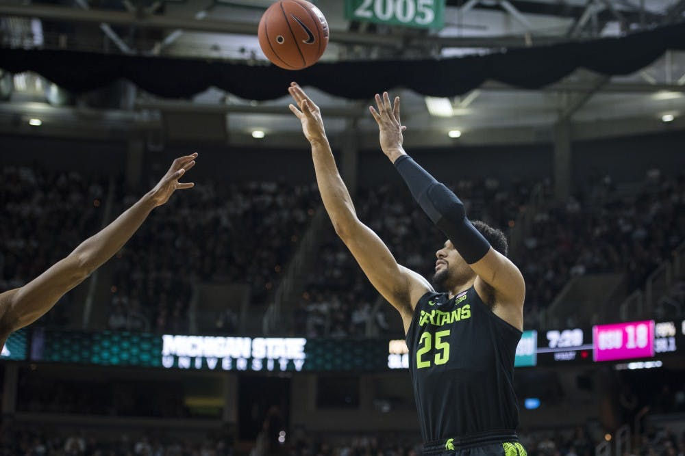 <p>Senior forward Kenny Goins (25) shoots the ball during the men&#x27;s basketball game against Ohio State at Breslin Center on Feb. 17, 2019. </p>