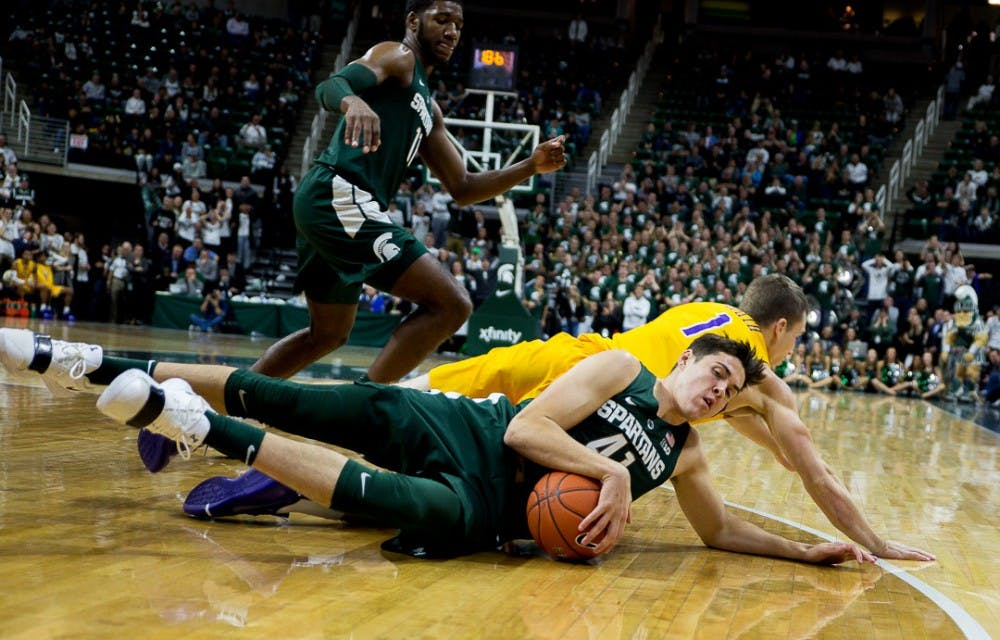 Redshirt junior guard Conner George (41) hangs onto the ball during the game against Tenessee Tech on Nov. 18, 2018 at the Breslin Center. The Spartans beat the Golden Eagles, 101-33.