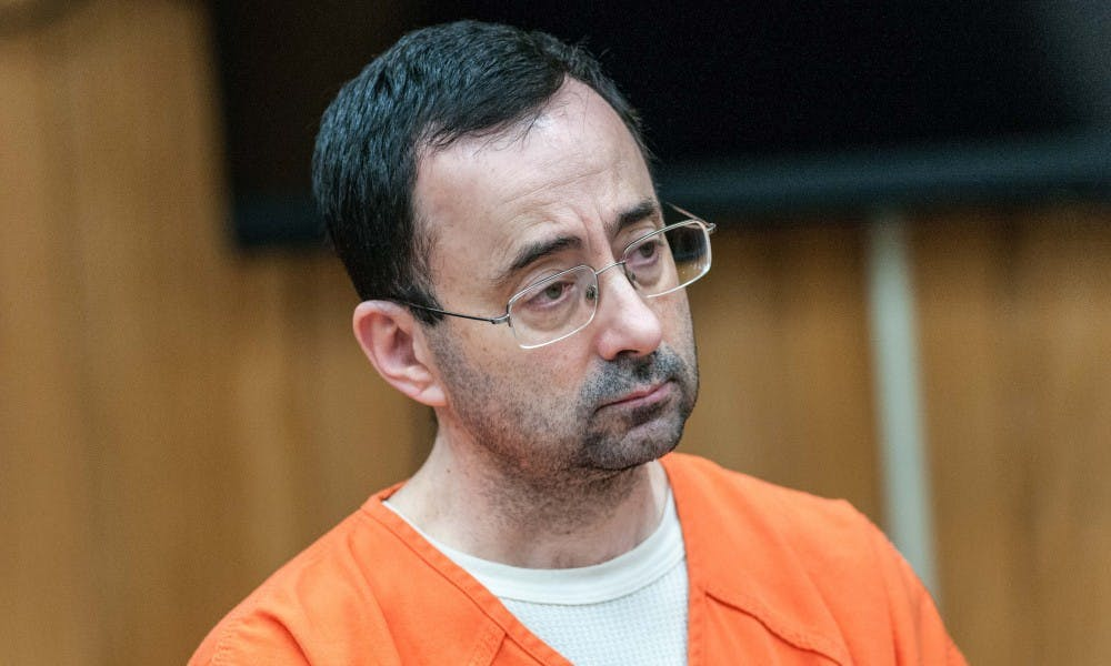 Larry Nassar listens to the judge during the plea hearing on Nov. 29, 2017, at the Eaton County Friend of Court. Nassar pleaded guilty to three counts.