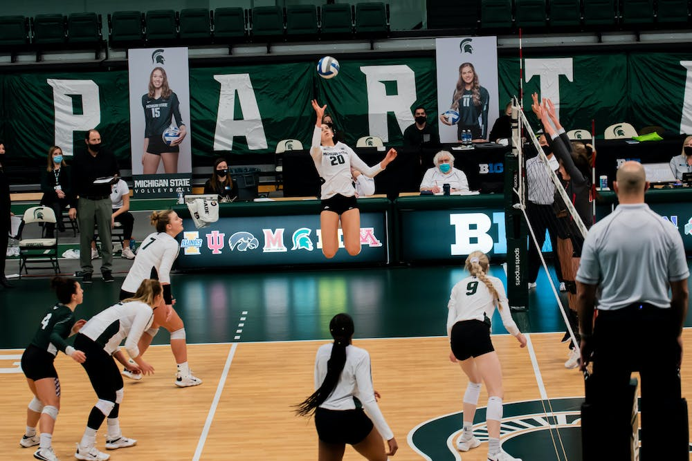 <p>Sophomore Cecilee Max-Brown returns the ball back over the net, during the Spartans&#x27; loss to Ohio State on Jan. 31.</p>