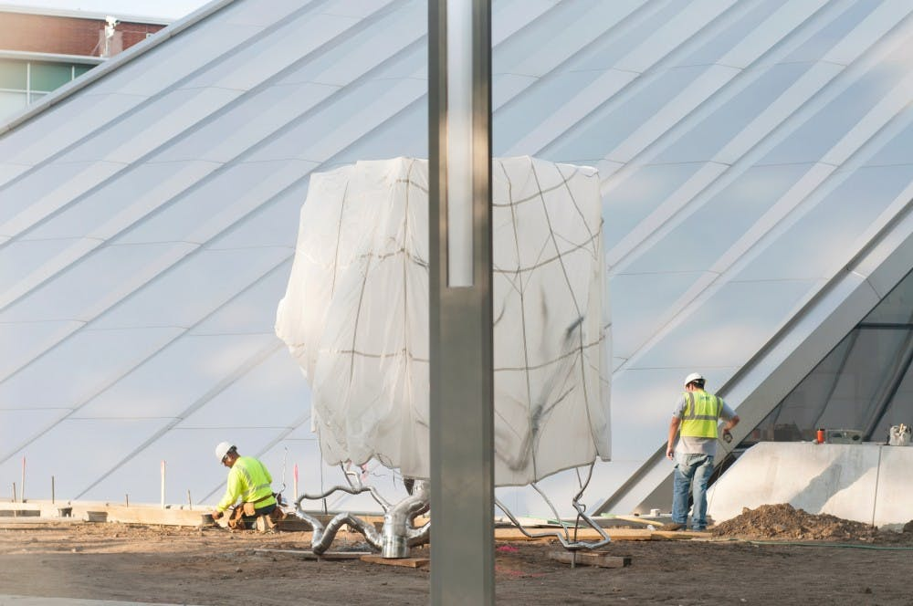 Construction workers near completion on the Eli and Edythe Broad Art Museum on Wednesday, Sept. 12, 2012. The museum is slated for completion on Nov. 9, 2012. Julia Nagy/The State News