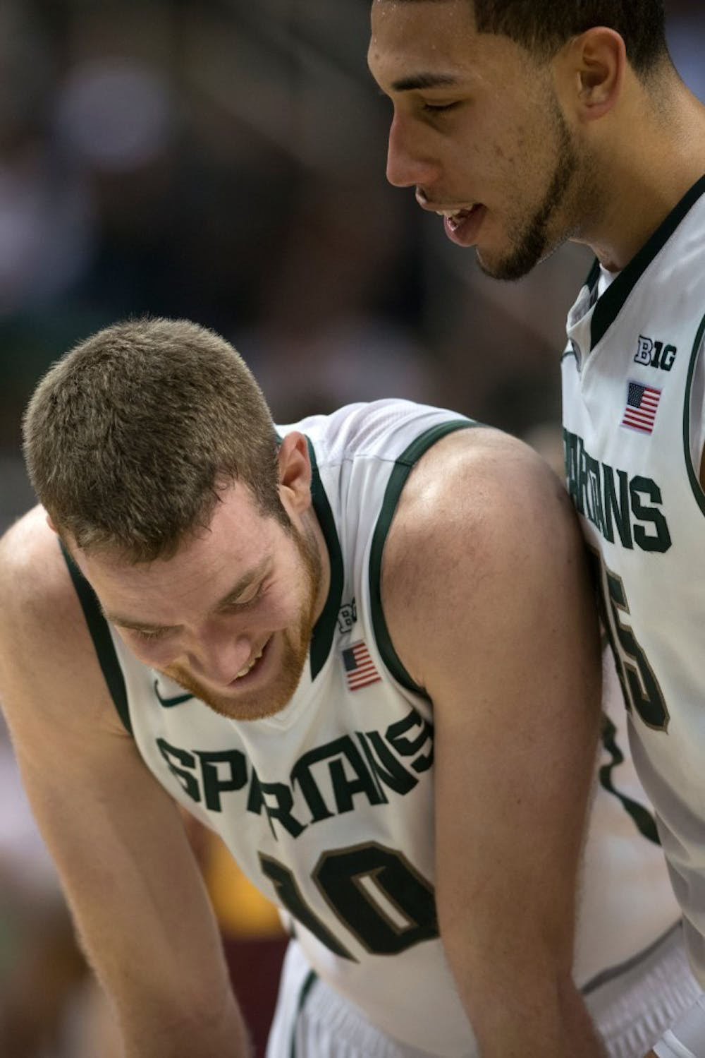 Sophomore forward Matt Costello and sophomore guard Denzel Valentine share a laugh Jan. 11, 2014, at Breslin Center during the game against Minnesota. The Spartans defeated the Gophers in overtime, 87-75. Julia Nagy/The State News