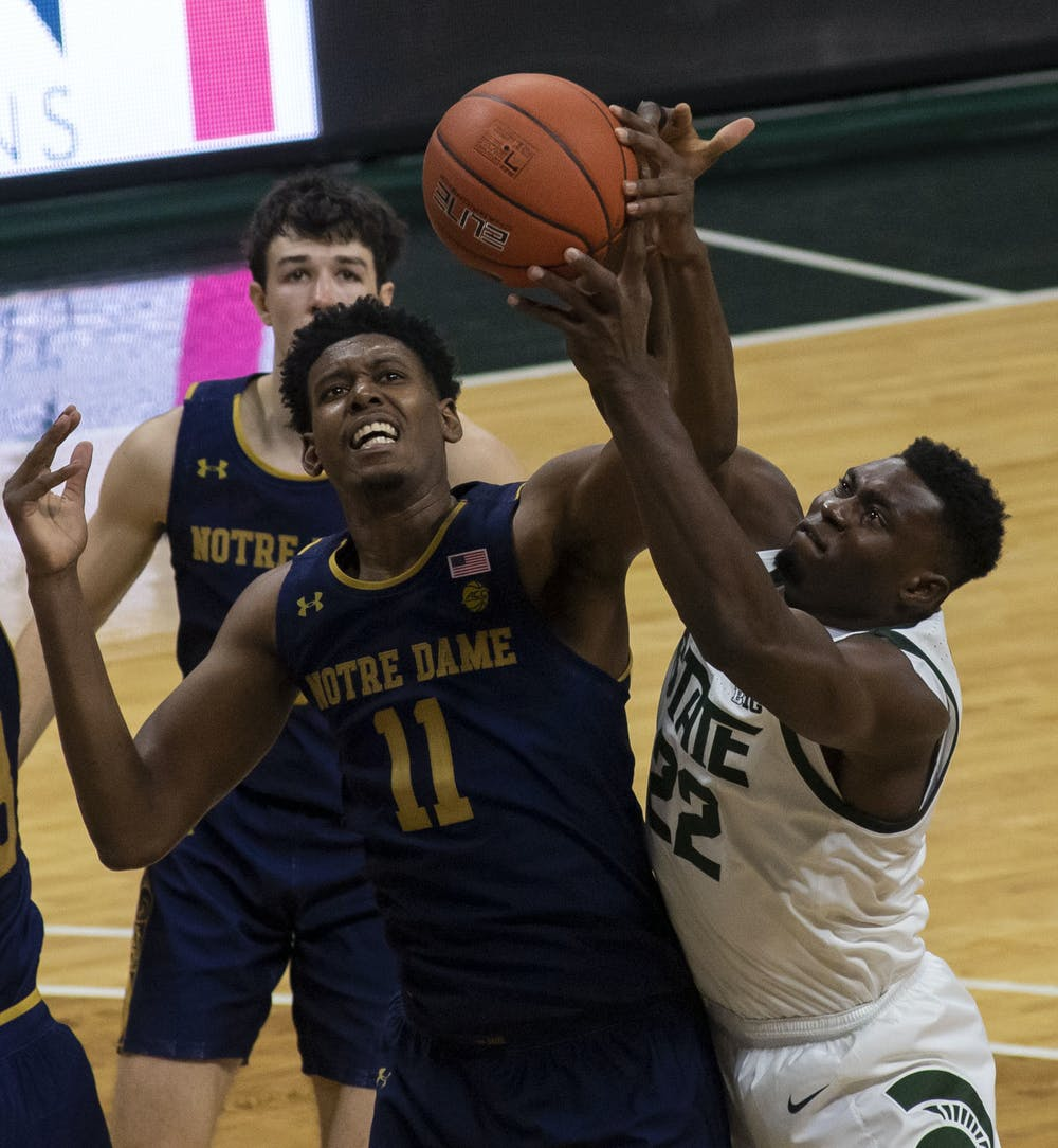 <p>Freshman center Mady Sissoko (22) fights to regain the ball after a failed shot at the basket in the second half. Michigan State triumphed over Notre Dame, 80-70, on Nov. 28, 2020. </p>