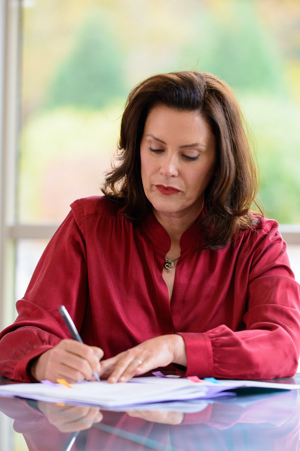 <p>Gov. Gretchen Whitmer signs bipartisan bills extending unemployment benefits to 26 weeks on Oct. 20, 2020. Courtesy photo provided by Michigan Executive Office of the Governor.</p>
