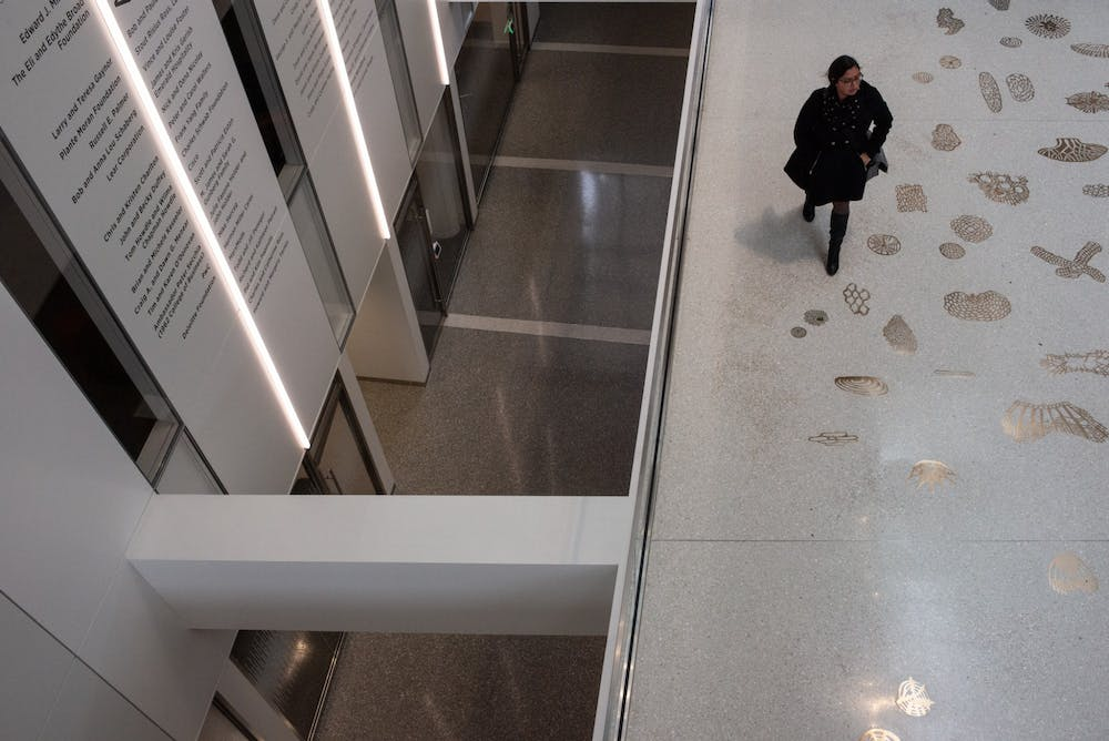<p>A student enters the Eppley Center after MSU released an email notifying students that administration has canceled classes after noon March 11, 2020.</p>