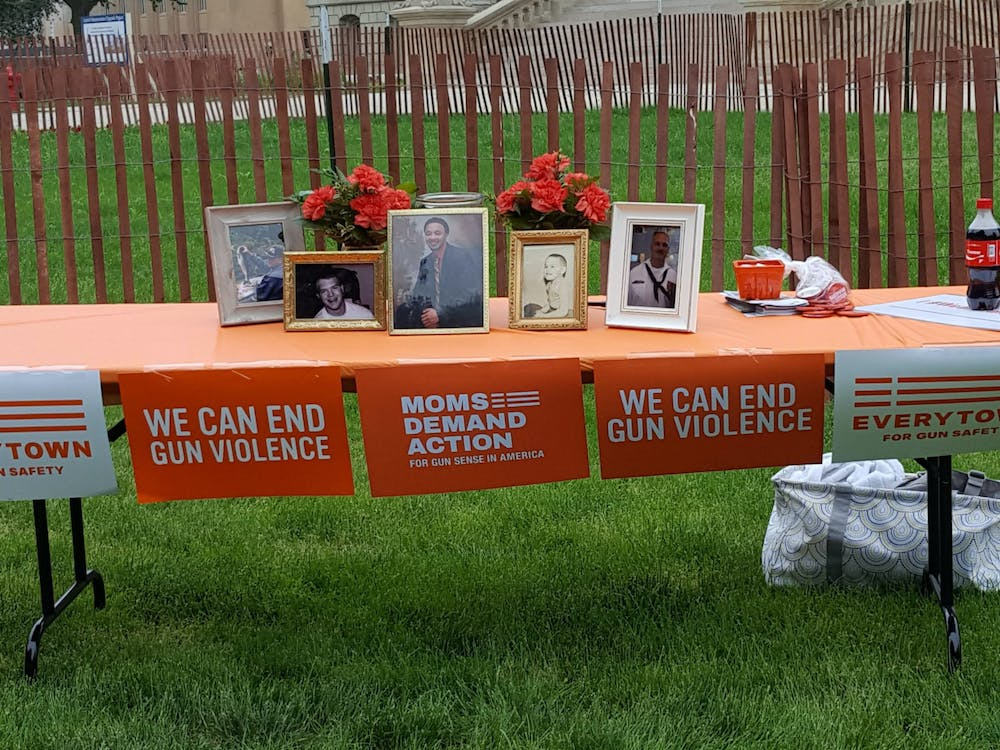 <p>A memorial table to local victims of gun violence from the 2018 Wear Orange event. Photo courtesy of .. </p>
