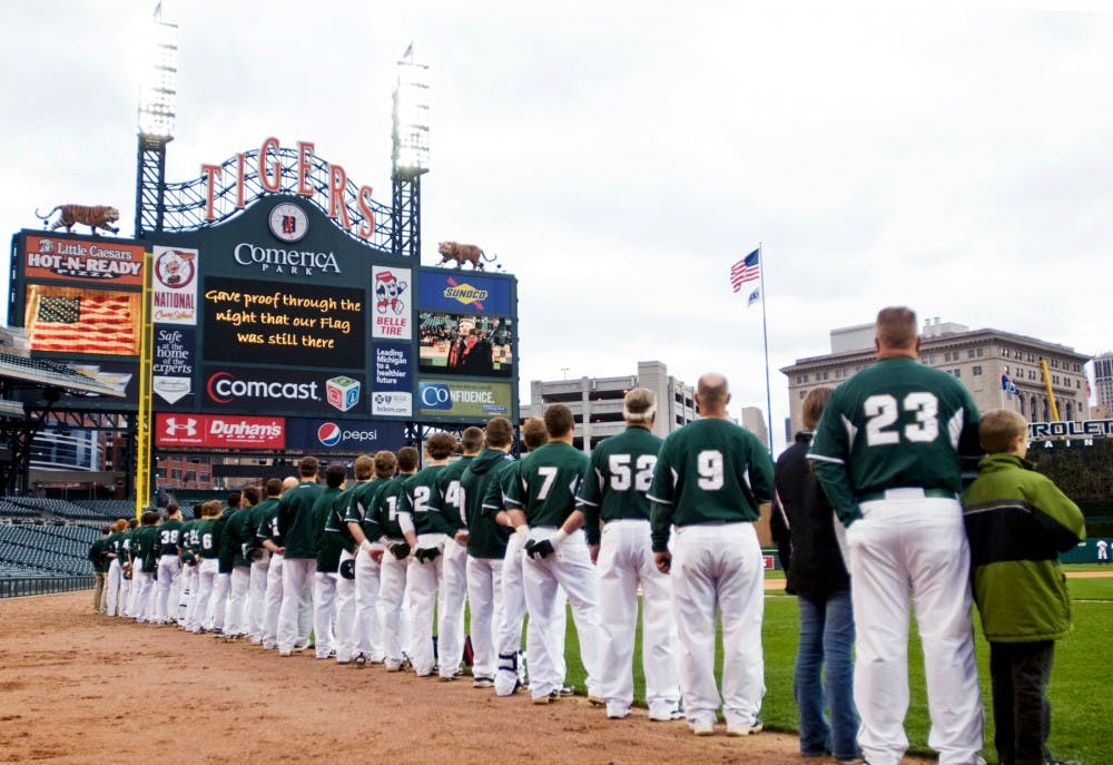 <p>The Spartans look toward the flag as the national anthem is sung Wednesday at Comerica Park in Detroit. The Spartans took on the Central Michigan Chippewas at the Detroit Tigers&#8217; home stadium in the Clash at Comerica. Matt Radick/The State News</p>