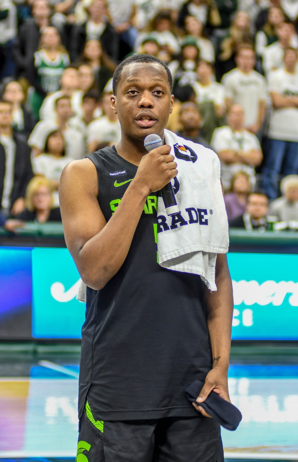 <p>Senior guard Cassius Winston (5) addresses the crowd after the game against the Charleston Southern Buccaneers on Nov. 18, 2019 at Breslin Center. The Spartans defeated the Buccaneers, 94-46.</p>