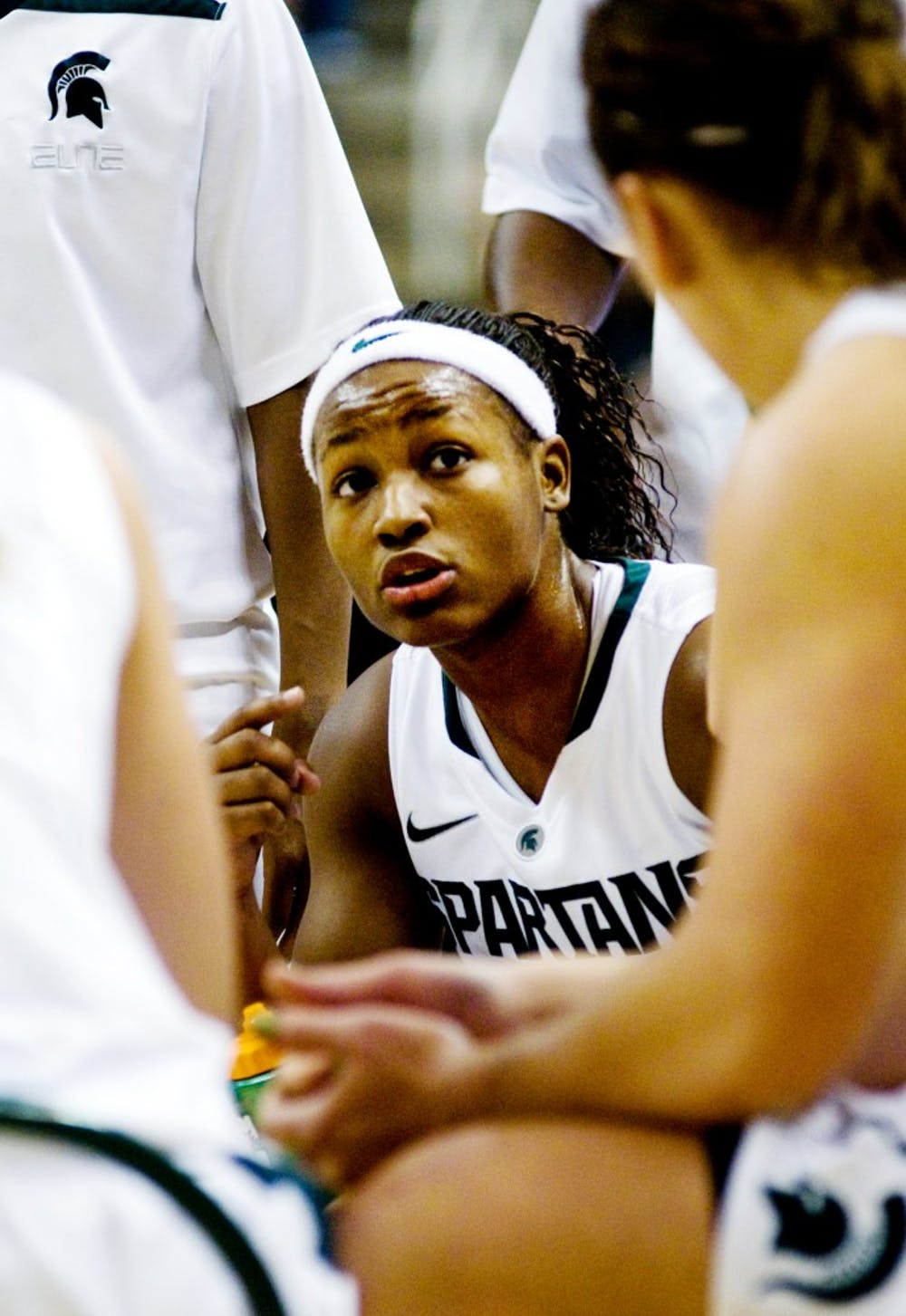 Freshman guard Kiana Johnson talks to her Michigan State teammates during a timeout Wednesday night at Breslin Center. The Spartans defeated the Wolverines 60-55. Aaron Snyder/The State News